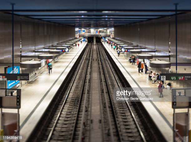 tilt shift image of the subway station oez, munich, germany - christian beirle stock pictures, royalty-free photos & images