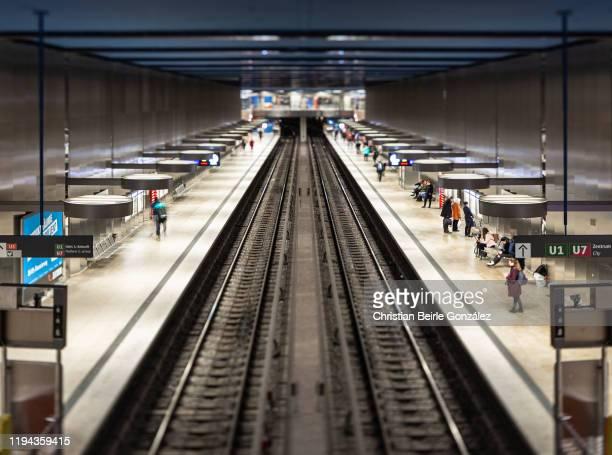 tilt shift image of the subway station oez, munich, germany - christian beirle stockfoto's en -beelden