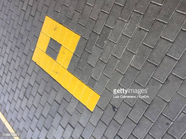 tilt shot of letter p on footpath - letter p stock pictures, royalty-free photos & images