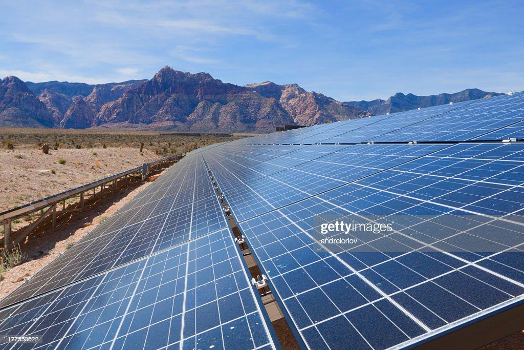 Tilted solar panels, near the mountains of the Mojave Desert : Stock Photo