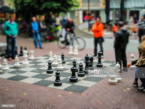Tilt-Shift Image Of Men And Chess Game On Street In City