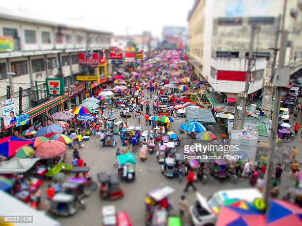 Tilt-Shift Image Of People At Market In City