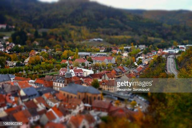 tilt-shift miniature aerial view of red tile roofs in schirmeck - lorraine stock pictures, royalty-free photos & images