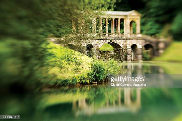Tiltshift view of the Palladian bridge at Prior Park garden in Bath taken on June 19 2009 The park was created in the 18th century by Ralph Allen and...