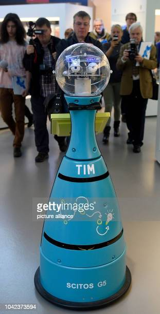 Tim a robot that works in the Technology Museum of Berlin guides visitors round the museum during a press conference at which the robot was unveiled...