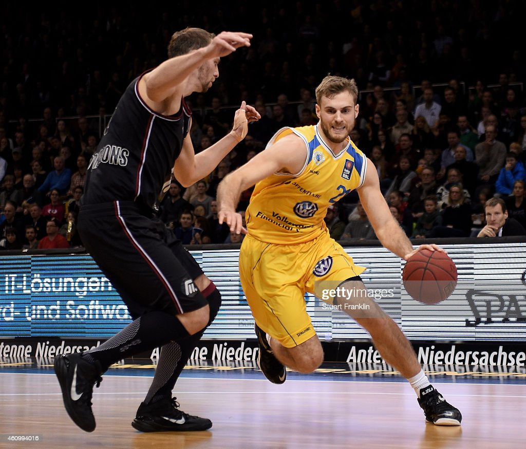 Tim Abromaitis of Braunschweig is challenged during the Bundesliga basketball game between Basketball Loewen Braunschweig and Artland Dragons on January 3, 2015 in Braunschweig, Germany.