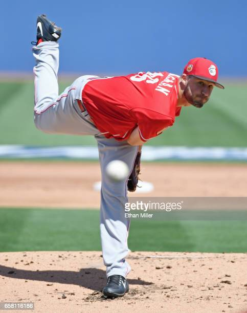 Tim Adleman of the Cincinnati Reds pitches against the Chicago Cubs during their exhibition game at Cashman Field on March 26 2017 in Las Vegas...
