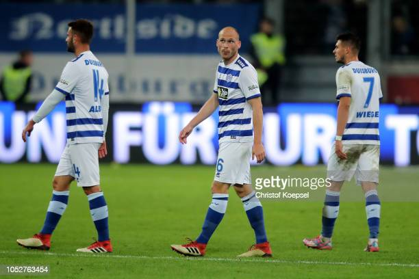 Tim Albutat Gerrit Nauber and Andreas Wiegel of Duisburg look dejected following their sides defeat 01 after the Second Bundesliga match between MSV...