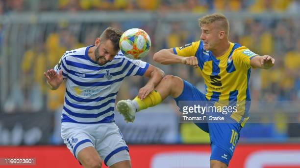 Tim Albutat of Duisburg and Martin Kobylanski of Braunschweig fight for the ball during the 3 Liga match between Eintracht Braunschweig and MSV...
