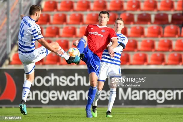 Tim Albutat of MSV Duisburg and Dominik Stroh-Engelof Unterhaching compete for the ball during the 3. Liga match between SpVgg Unterhaching and MSV...