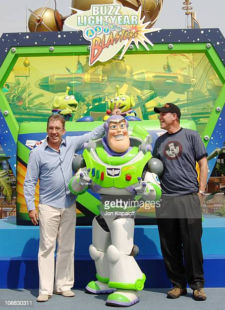 Tim Allen and Michael Eisner with Buzz Lightyear during The Official Opening of the Buzz Lightyear Astro Blasters Tomorrowland Attraction at...
