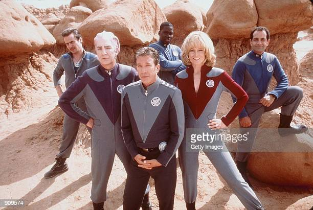 Tim Allen Sigourney Weaver Alan Rickman Sam Rockwell Tony Shalhoub and Daryl Mitchell stars in the movie Galaxy Quest Photo Dreamworks