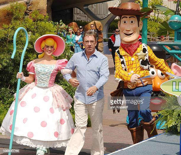Tim Allen with Bo Peep and Woody during The Official Opening of the Buzz Lightyear Astro Blasters Tomorrowland Attraction at Disneyland at Disneyland...