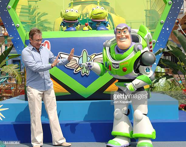 Tim Allen with Buzz Lightyear during The Official Opening of the Buzz Lightyear Astro Blasters Tomorrowland Attraction at Disneyland at Disneyland in...
