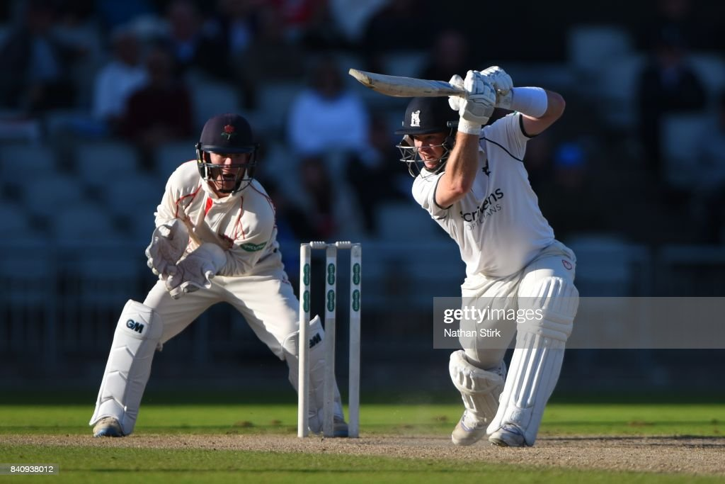 Tim Ambrose of Warwickshire drives the ball during the County Championship Division One match between Lancashire and Warwickshire at Old Trafford on August 30, 2017 in Manchester, England.