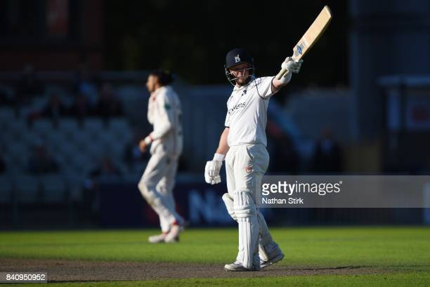 Tim Ambrose of Warwickshire raises his bat after scoring 50 runs during the County Championship Division One match between Lancashire and...