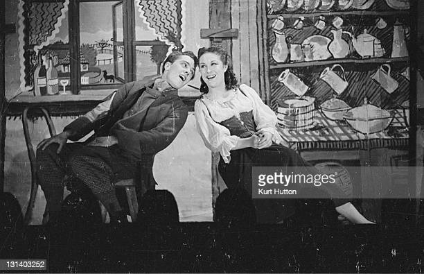 Tim and Anne Marten performing the Gobble Duet in a scene from moral domestic drama 'Maria Marten' at the Arts Theatre Club 12th December 1942...