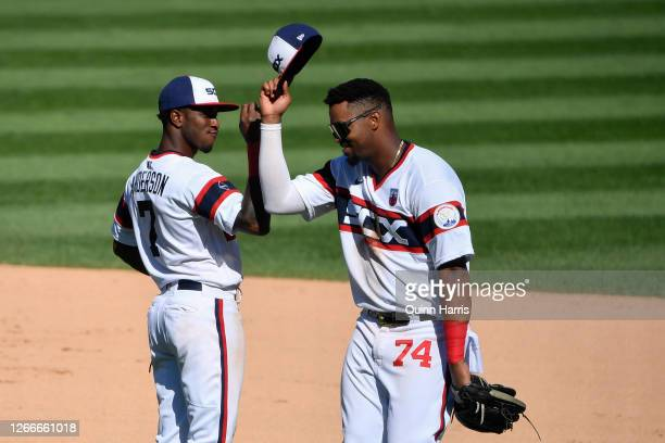 Tim Anderson and Eloy Jimenez of the Chicago White Sox celebrate the team win against the St Louis Cardinals at Guaranteed Rate Field on August 16...