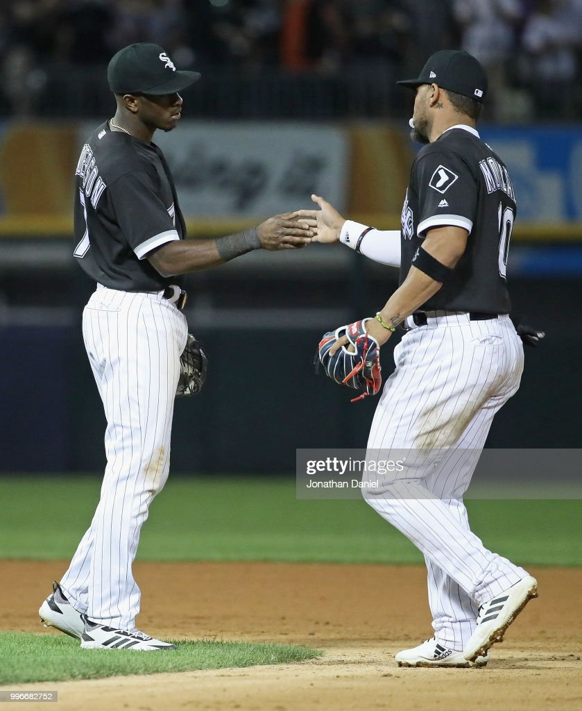Tim Anderson #7 (L) and Yoan Moncada #10 of the Chicago White Sox celebrate a win over the St. Louis Cardinals at Guaranteed Rate Field on July 11, 2018 in Chicago, Illinois. The White Sox defeated the Cardinals 4-0.