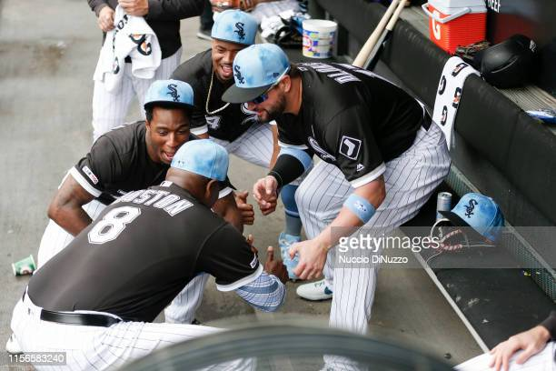 Tim Anderson first base coach Daryl Boston Eloy Jimenez and Yonder Alonso of the Chicago White Sox prior to the game against the New York Yankees at...