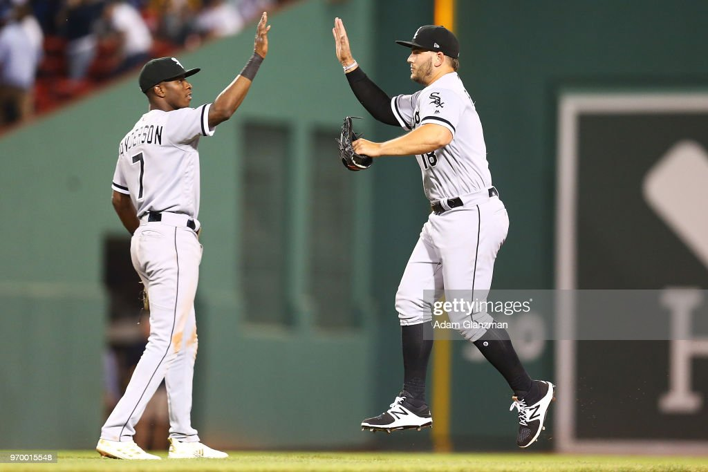 Tim Anderson #7 high fives Daniel Palka #18 of the Chicago White Sox after a victory over the Boston Red Sox at Fenway Park on June 08, 2018 in Boston, Massachusetts.