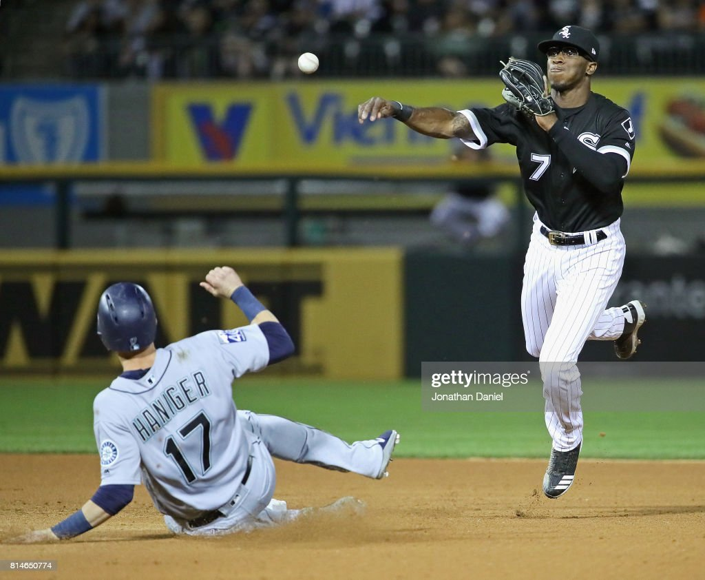 Tim Anderson #7 of the Chicago White Sox attempts to turn a double play over Mitch Haniger #17 of the Seattle Mariners in the 6th inning at Guaranteed Rate Field on July 14, 2017 in Chicago, Illinois.