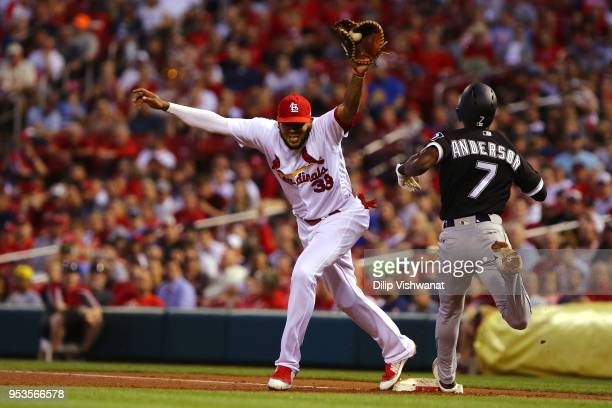 Tim Anderson of the Chicago White Sox can't beat the throw to Jose Martinez of the St Louis Cardinals for an out at first base in the third inning at...