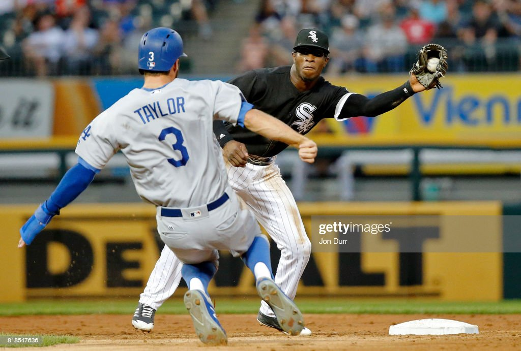 Tim Anderson #7 of the Chicago White Sox catches the ball before tagging out Chris Taylor #3 of the Los Angeles Dodgers for the second out of a double play during the second inning at Guaranteed Rate Field on July 18, 2017 in Chicago, Illinois.