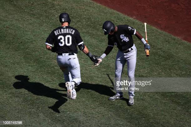 Tim Anderson of the Chicago White Sox congratulates Nicky Delmonico of the Chicago White Sox after his solo homerun during the seventh inning of a...