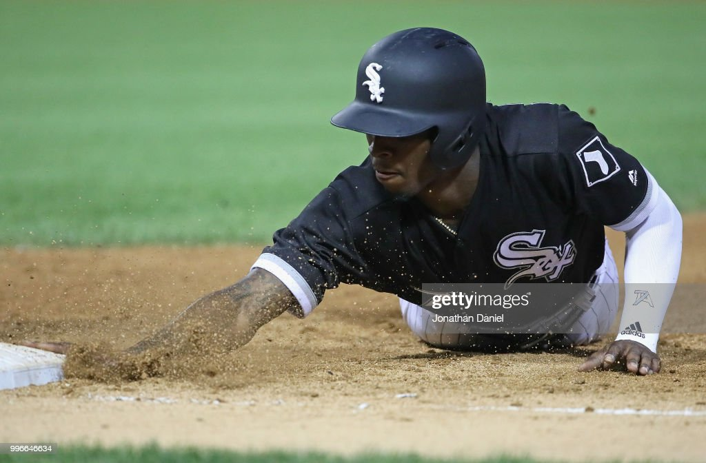 Tim Anderson #7 of the Chicago White Sox dives back safely into first base in the 5th inning against the St. Louis Cardinals at Guaranteed Rate Field on July 11, 2018 in Chicago, Illinois.