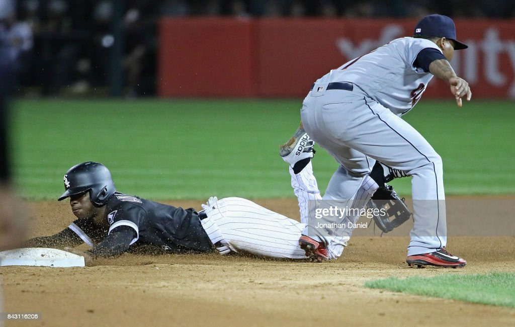 Tim Anderson #7 of the Chicago White Sox dives safely into second base as Jose Ramirez #11 of the Cleveland Indians misses the throw in the 6th inning at Guaranteed Rate Field on September 5, 2017 in Chicago, Illinois.