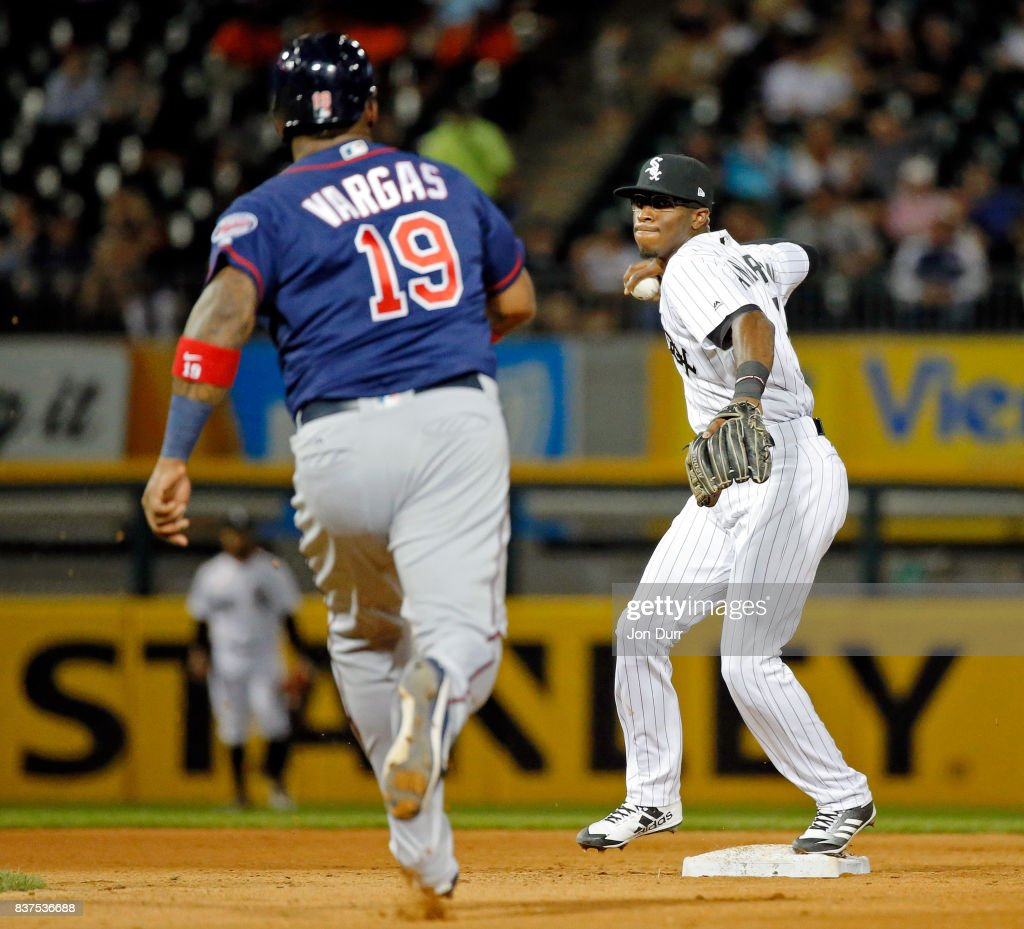 Tim Anderson #7 of the Chicago White Sox forces out Kennys Vargas #19 of the Minnesota Twins and throws to first base to complete a double play during the seventh inning at Guaranteed Rate Field on August 22, 2017 in Chicago, Illinois.