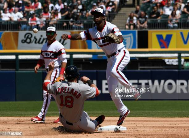 Tim Anderson of the Chicago White Sox forces out Mitch Moreland of the Boston Red Sox at second base then throws to first base to complete a double...