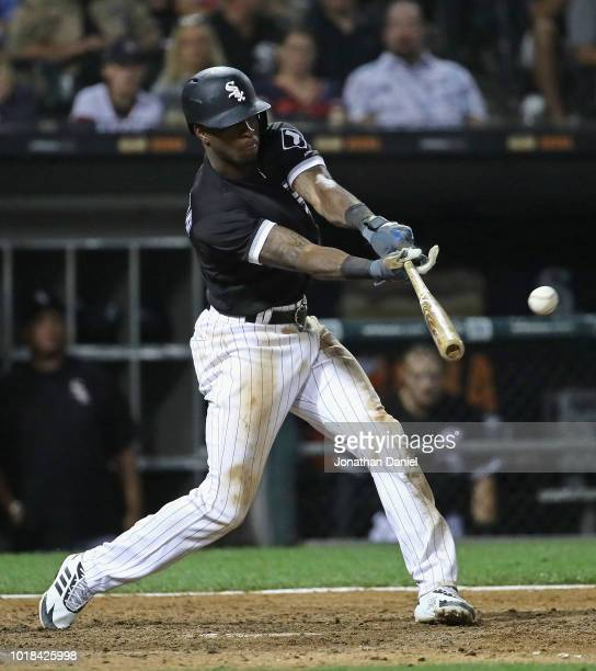 Tim Anderson of the Chicago White Sox hits a run scoring single in the 7th inning against the Kansas City Royals at Guaranteed Rate Field on August...
