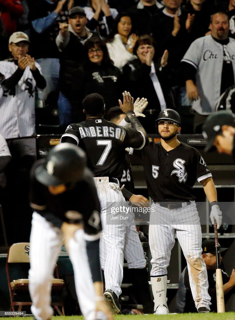 Tim Anderson #7 of the Chicago White Sox is congratulated by Yolmer Sanchez #5 after scoring on an RBI single hit by Rymer Liriano #48 (not pictured) during the eighth inning at Guaranteed Rate Field on September 28, 2017 in Chicago, Illinois. The Chicago White Sox won 5-4.