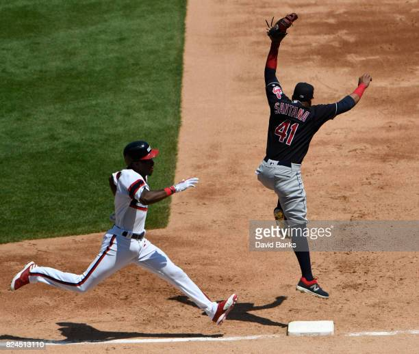 Tim Anderson of the Chicago White Sox is safe at first base as Carlos Santana of the Cleveland Indians can't handle an errant throw during the third...