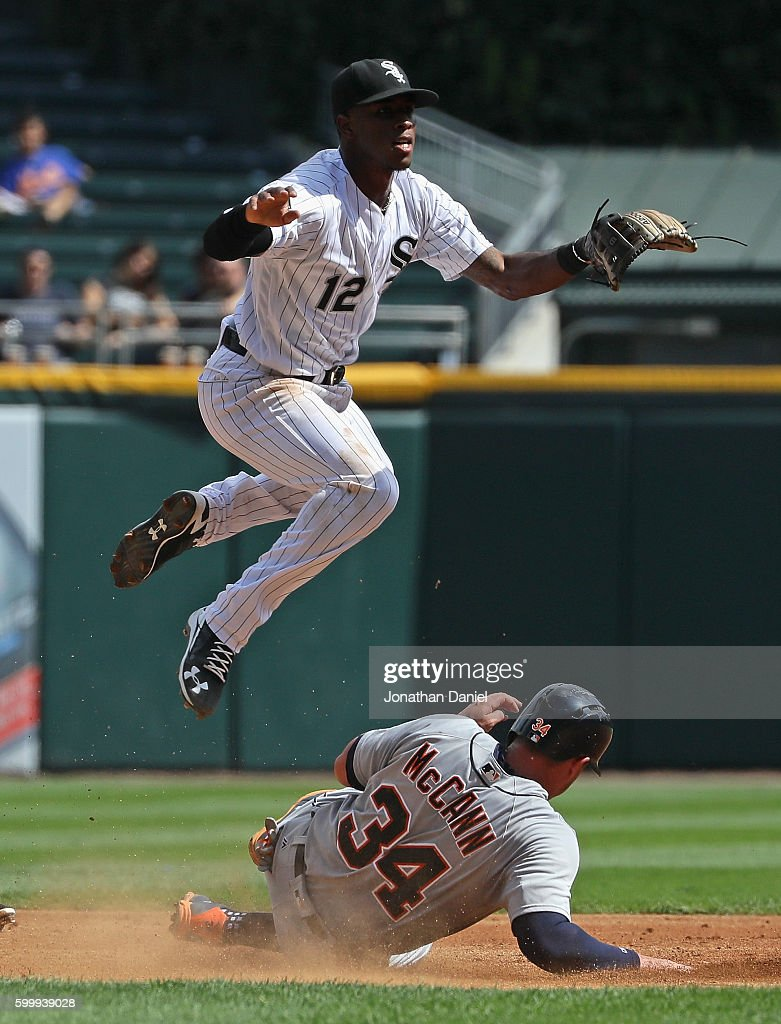 Tim Anderson #12 of the Chicago White Sox leaps over James McCann #34 of the Detroit Tigers as he turns a double play in the 2nd inning at U.S. Cellular Field on September 7, 2016 in Chicago, Illinois.