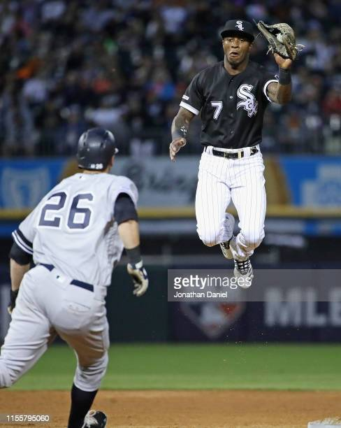 Tim Anderson of the Chicago White Sox leaps to catch a high throw to turn a double play against DJ LeMahieu of the New York Yankees at Guaranteed...