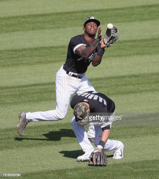 Tim Anderson of the Chicago White Sox makes a catch as Nick Madrigal ducks out of the way against the Kansas City Royals at Guaranteed Rate Field on...