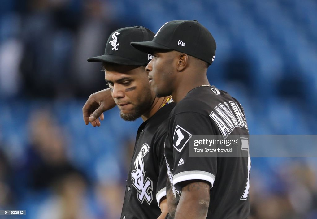 Tim Anderson #7 of the Chicago White Sox puts his arm around Yoan Moncada #10 during a pitching change in the eighth inning during MLB game action against the Toronto Blue Jays at Rogers Centre on April 3, 2018 in Toronto, Canada.