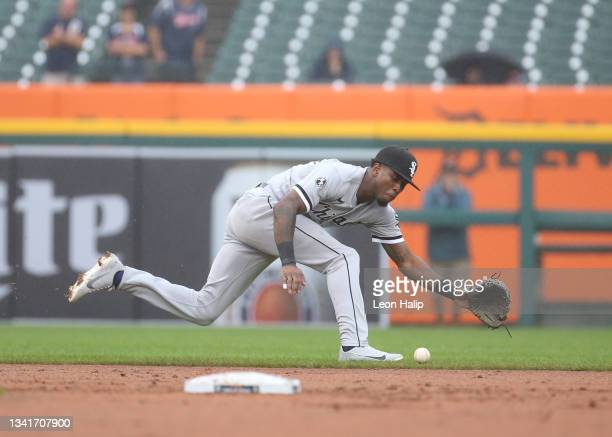 Tim Anderson of the Chicago White Sox reaches for the ball during the second inning of the game against the Detroit Tigers at Comerica Park on...