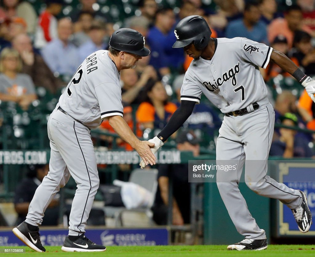 Tim Anderson #7 of the Chicago White Sox receives congratulations from third base coach Nick Capra #12 after hitting a home run in the eighth inning against the Houston Astros at Minute Maid Park on September 21, 2017 in Houston, Texas.