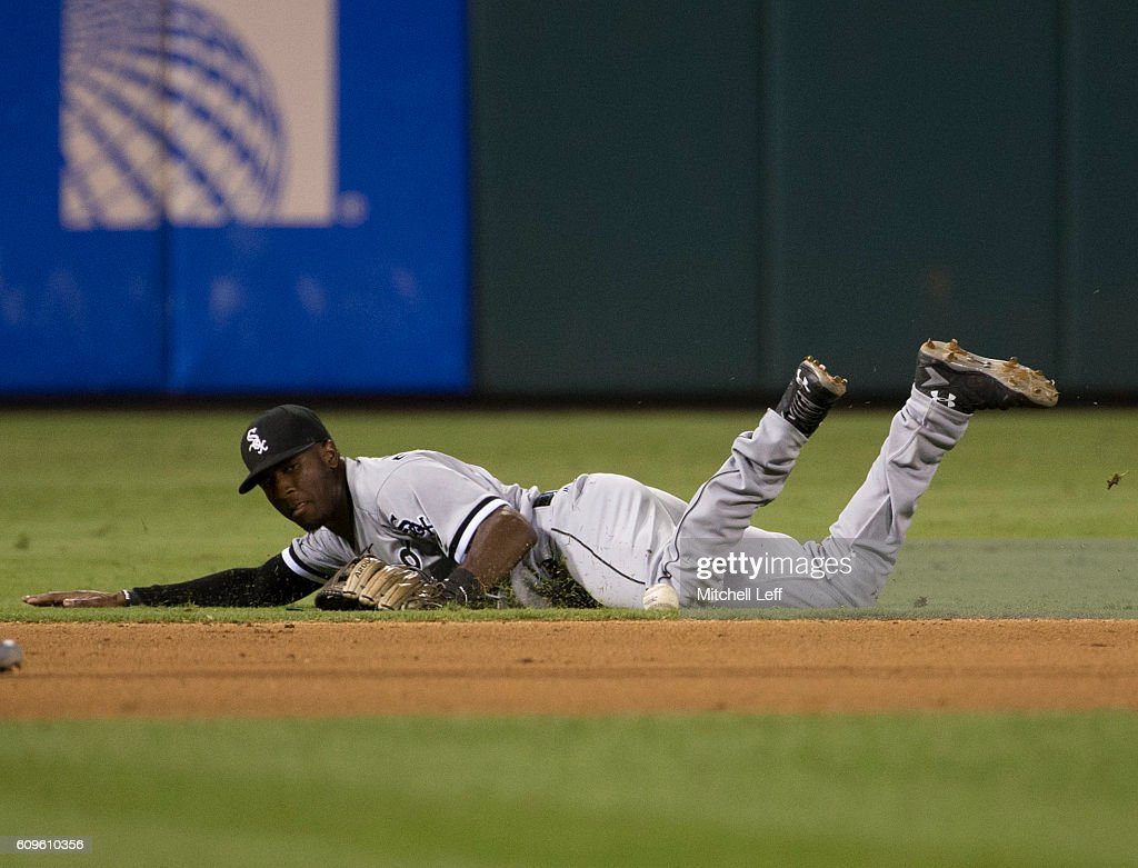 Tim Anderson #12 of the Chicago White Sox stops the ball hit by Cameron Rupp #29 of the Philadelphia Phillies (NOT PICTURED) in the bottom of the seventh inning at Citizens Bank Park on September 21, 2016 in Philadelphia, Pennsylvania. The Phillies defeated the White Sox 8-3.