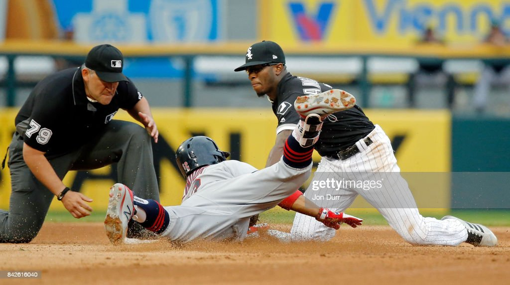 Tim Anderson #7 of the Chicago White Sox tags out Francisco Lindor #12 of the Cleveland Indians at second base during the fifth inning at Guaranteed Rate Field on September 4, 2017 in Chicago, Illinois.