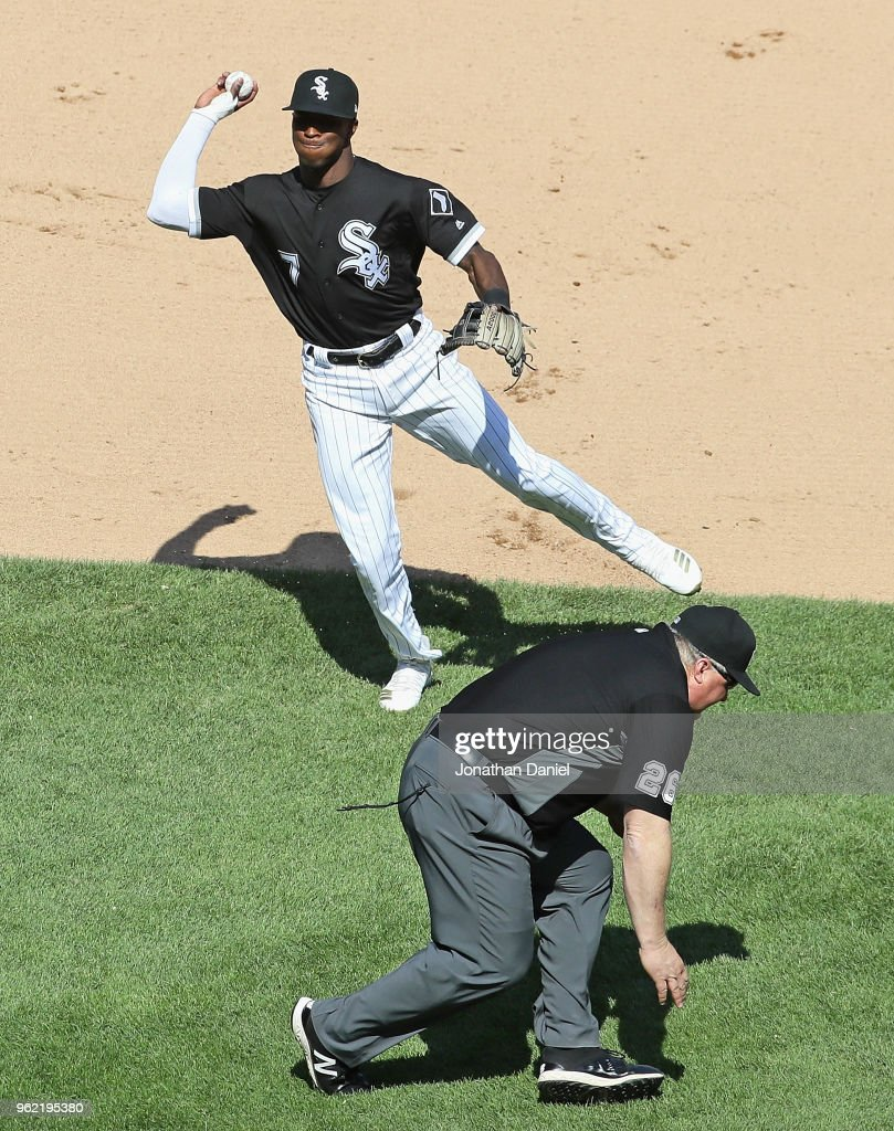 Tim Anderson #7 of the Chicago White Sox throws to first base as second base umpire Bill Miller #26 ducks out of the way in the 7th inning against the Baltimore Orioles at Guaranteed Rate Field on May 24, 2018 in Chicago, Illinois. The Orioles defeated the White Sox 9-3.