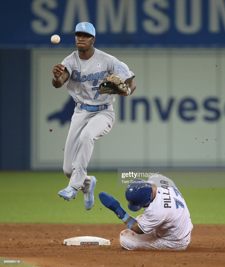 Tim Anderson #7 of the Chicago White Sox turns a double play in the sixth inning during MLB game action as Kevin Pillar #11 of the Toronto Blue Jays slides into second base at Rogers Centre on June 17, 2017 in Toronto, Canada.