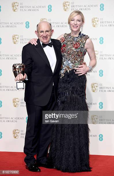 Tim Angel winner of the Outstanding British Contribution to Cinema for 'Angels Costumes' and Cate Blanchett pose in the winners room at the EE...