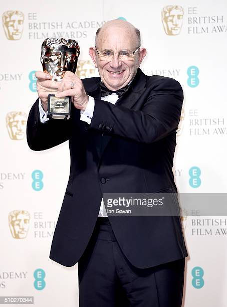 Tim Angel winner of the Outstanding British Contribution to Cinema for 'Angels Costumes' poses in the winners room at the EE British Academy Film...