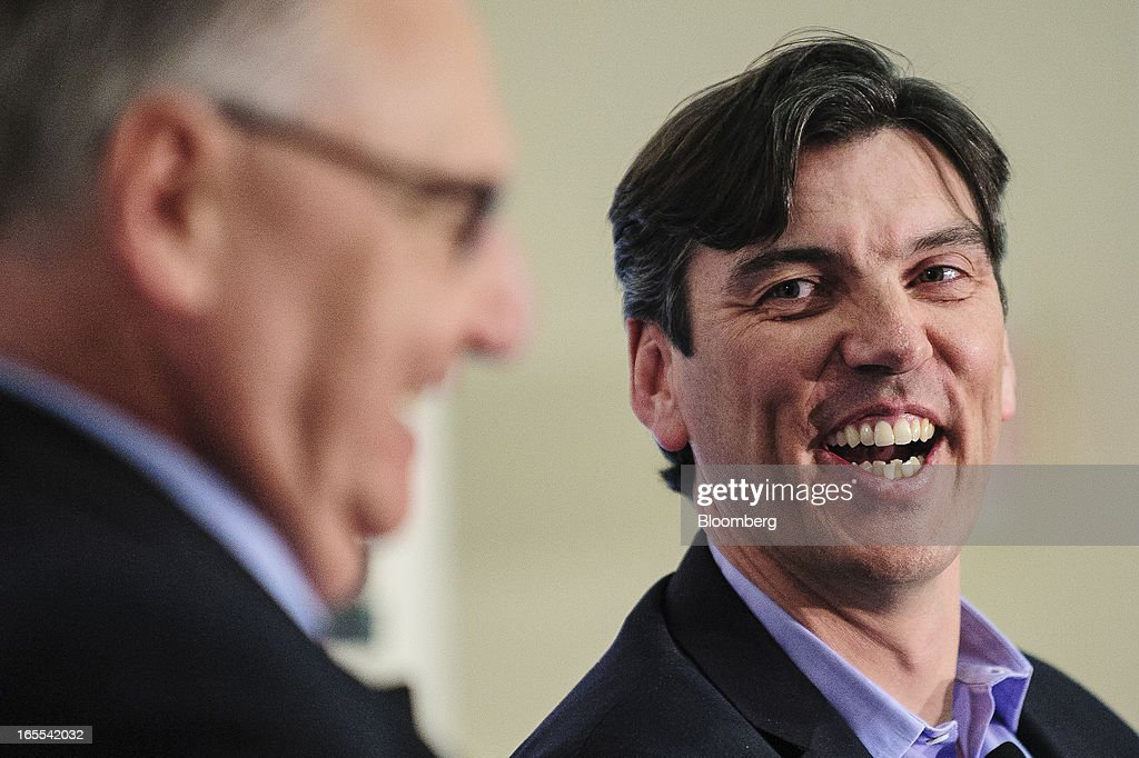 Tim Armstrong, chief executive officer of AOL Inc., right, laughs while speaking at the Society of American Business Editors and Writers (SABEW) 2013 Spring Conference in Washington, D.C., U.S., on Thursday, April 4, 2013. AOL today announced a dual-syndication agreement for video content with Publishing Group of America. Photographer: Pete Marovich/Bloomberg via Getty Images
