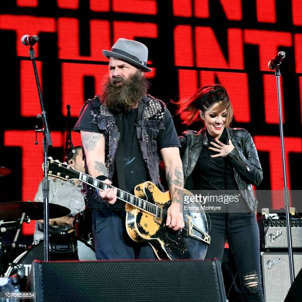Tim Armstrong of the band Rancid and Aimee Allen of the band The Interrupters perform on stage during the KROQ Absolut Almost Acoustic Christmas at...